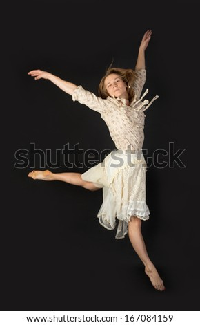 jumping girl in a dress on a black background
