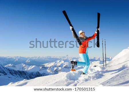 Jumping girl in fresh snow powder - winter fun - stock photo