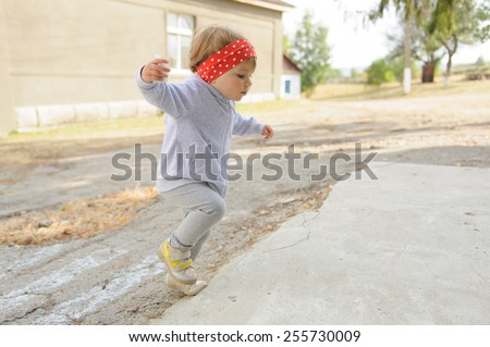 jumping girl in yard as sunny day - stock photo