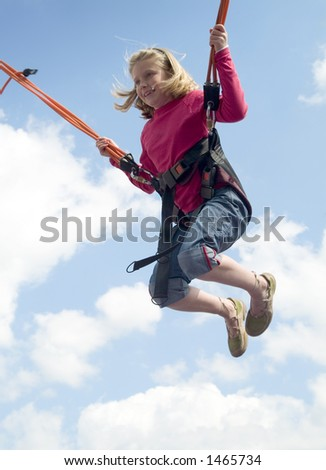 jumping girl (trampoline at the funfair)
