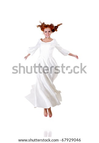 jumping happy bride isolated on white - stock photo