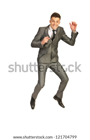 Jumping happy business man isolated on white background