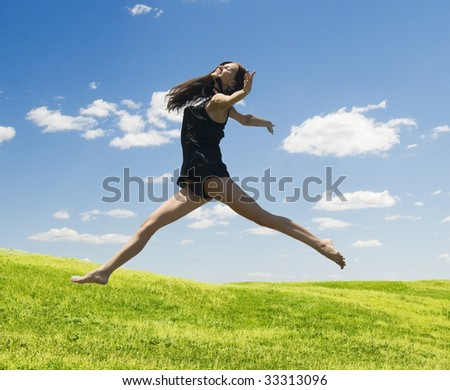 jumping happy woman against nature background