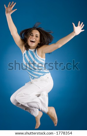jumping happy woman on the blue background - stock photo
