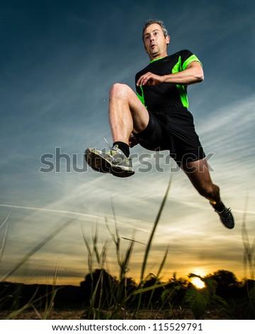 jumping man in sunrise - stock photo