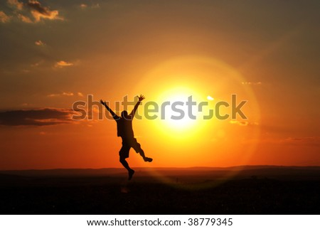 jumping man in sunset