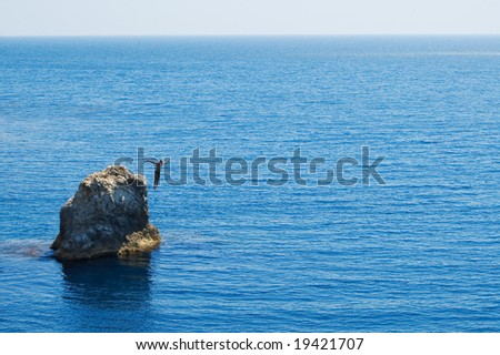 jumping man on blue sea - stock photo