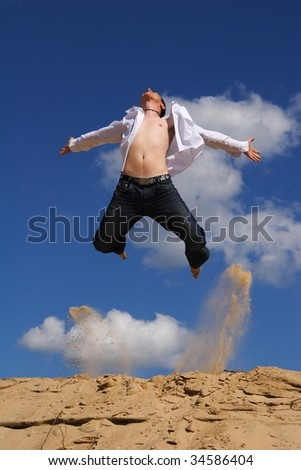 jumping man with blue sky on the background - stock photo