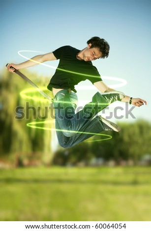 Jumping man with energy beams, outdoor - stock photo
