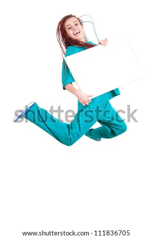 jumping medical woman with blank placard, full length, white background - stock photo