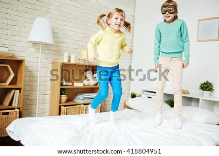 Jumping on bed - stock photo