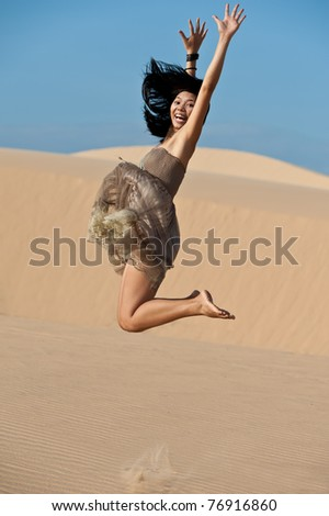 Jumping on dunes - stock photo