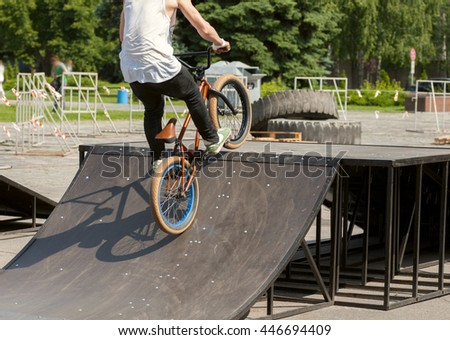 jumping on the bike - stock photo