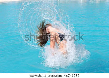 jumping out of pool - stock photo
