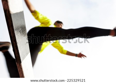 jumping over a hurdle - stock photo