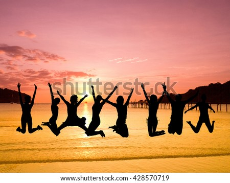 Jumping over Sunset Excited  - stock photo