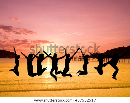 Jumping over Sunset Friends Silhouettes  - stock photo