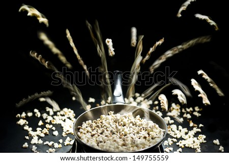 Jumping pop corn - stock photo