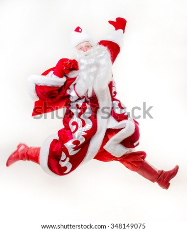 Jumping Santa Claus on white background. Isolated - stock photo