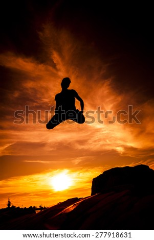Jumping Silhouette - stock photo