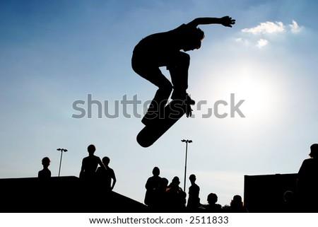 Jumping skateboarder silhouette - stock photo