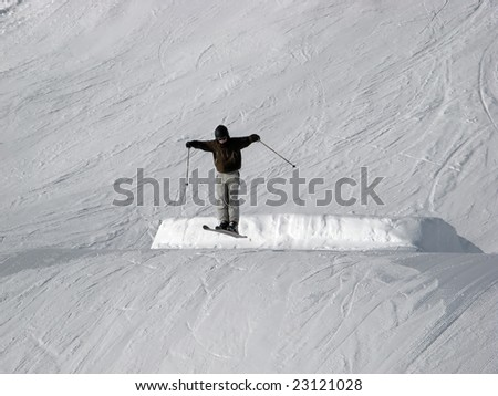 Jumping skier over the slope