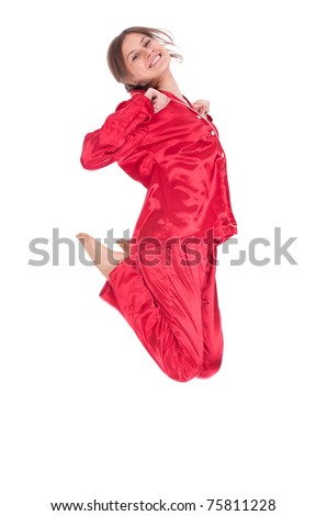 jumping smiling young woman in red pajamas, full length, series - stock photo