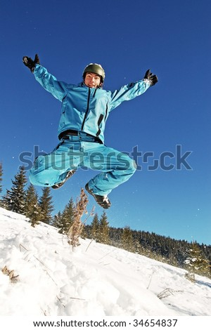 jumping snowboarder - stock photo