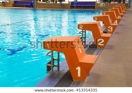 Jumping stand marked number one to eight in the lanes of swimming pool, water sport, swimming pool center. - stock photo