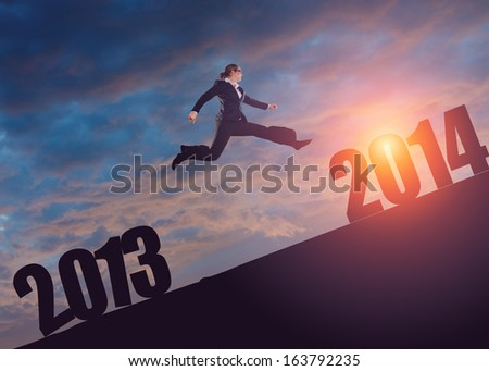 jumping to the 2014 - stock photo