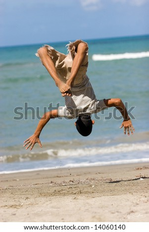 jumping upside down at the seaside