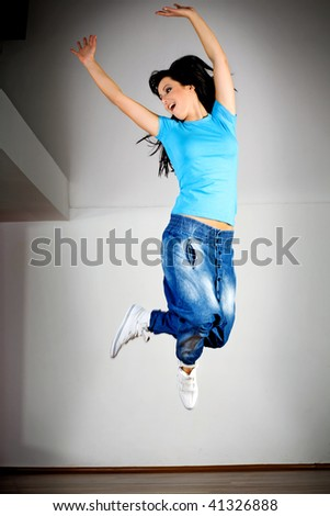 Jumping woman - stock photo