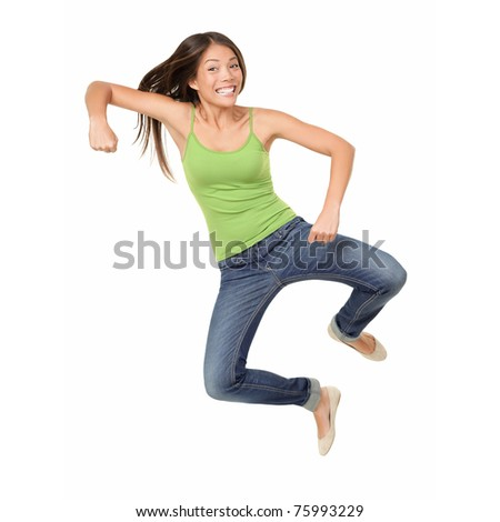 Jumping woman isolated. Funny jumping casual mixed race Asian Caucasian woman isolated on white background wearing reen tank top and jeans - stock photo