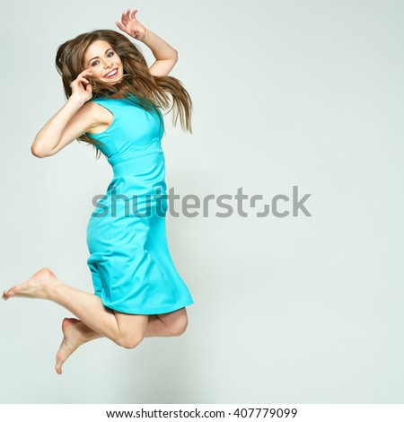 Jumping woman isolated portrait. Happy emotional girl. Long hair in motion.