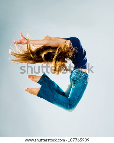 Jumping Woman on a light background - stock photo