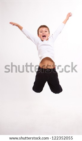 Jumping young boy on a truck suit - stock photo