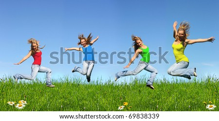 Jumping young girl in  blue jeans outdoors - stock photo