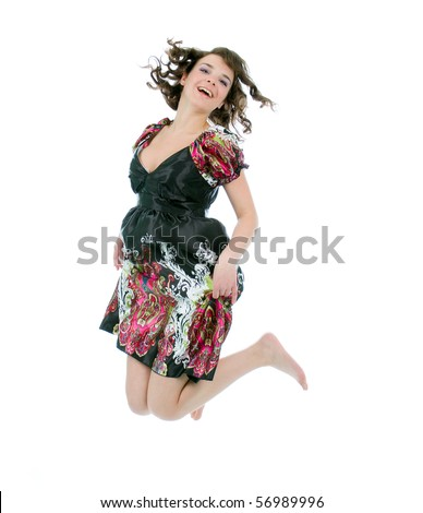 Jumping Young Girl. Studio Shoot Over White Background.