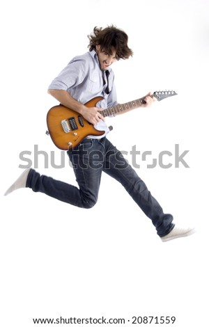 jumping young male with guitar with white background - stock photo