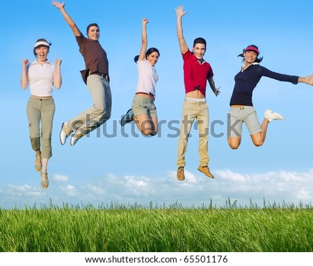 Jumping young people happy group in meadow blue sky outdoor [Photo Illustration]