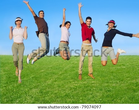 Jumping young people happy group in meadow blue sky outdoor [Photo Illustration] - stock photo