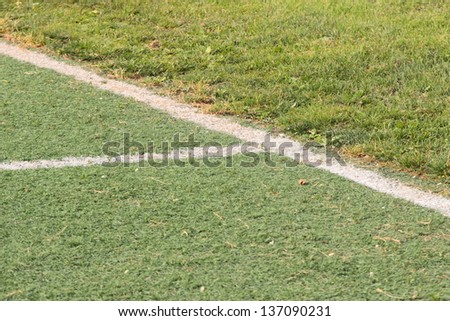 Junction between grass and astroturf in a 2  rugby playgrounds
