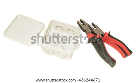 junction box for electrical wiring and two pliers isolated on white background - stock photo