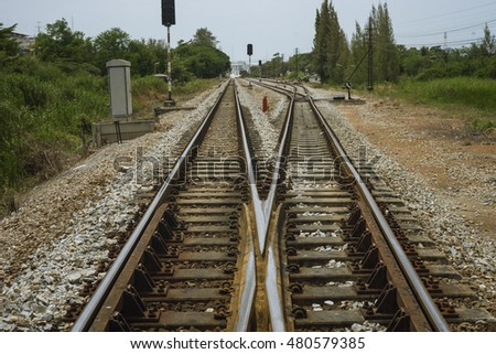 junction of railway track with green tree at left and right side of railway.filtered image.choose for life concept.choice of life concept