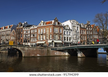 Junction of two canals in Amsterdam in the Netherlands in Europe. - stock photo