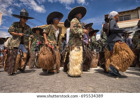 June 25, 2017 Cotacachi, Ecuador: low angle view of quechua indigenous men wearing chaps at Inti Raymi celebration