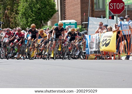 JUNE 15, 2014: Cyclists race for lead at final stage of 2014 North Star Grand Prix in Stillwater, Minnesota. About 300 top pro cyclists from around the world compete in the prestigious event. - stock photo