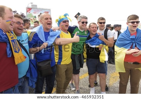 June 16, 2016 - Lyon, Auvergne-Rhone-Alpes, France.  Northern Irish and Ukrainian fans meet and mingle outside Parc Olympique Lyonnais, prior to their European Championship match.