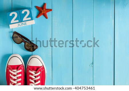 June 22nd. Image of june 22 wooden color calendar on blue background. Summer day. Empty space for text - stock photo