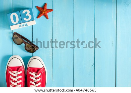 June 3rd. Image of june 3 wooden color calendar on blue background.  Summer day, empty space for text - stock photo